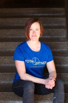 Amanda Cole Total Balance Fitness headshot stairs.jpg
